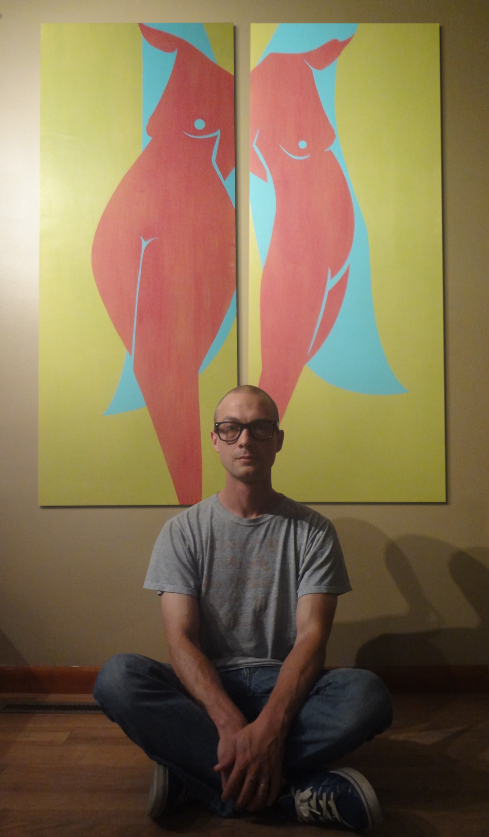 Artist Troy DeShano with painting